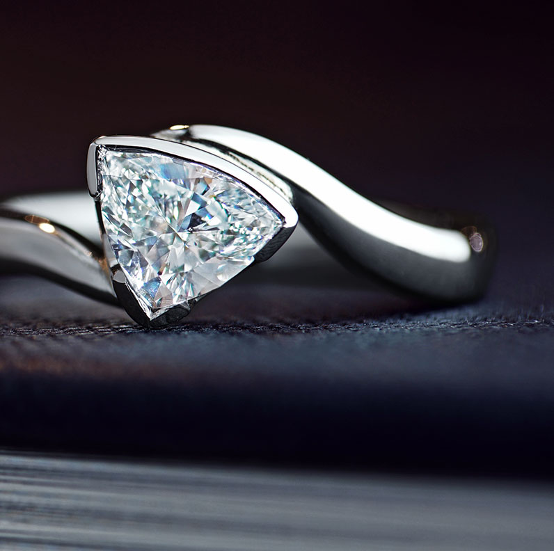 10208-Platinum-twist-style-solitaire-with-a-0-54ct-bow-sided-trillion-cut-diamond_9.jpg
