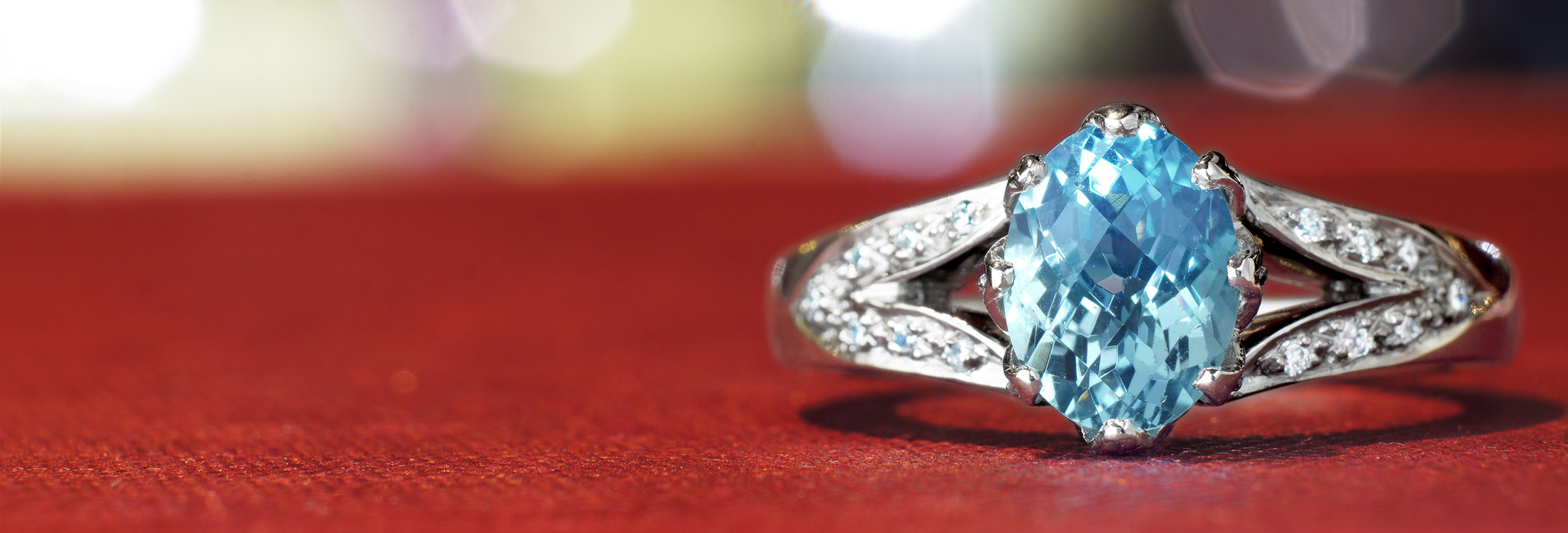 Vintage floral inspired aquamarine and diamond engagement ring