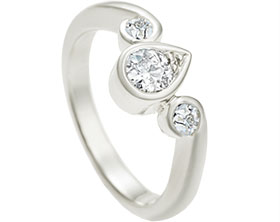 12877-bespoke-9ct-white-gold-engagement-ring-with-central-diamond-an-two-round-cut-diamonds_1.jpg