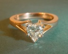 18ct rose gold engagement ring with an h si 0.45ct heart shaped diamond