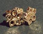 flower shaped earrings in 9ct gold