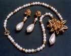 pendant and earring set in antiqued gold finish and dyed ivory pearly beads