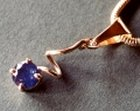sapphire pendant set in 18ct gold with a snake chain