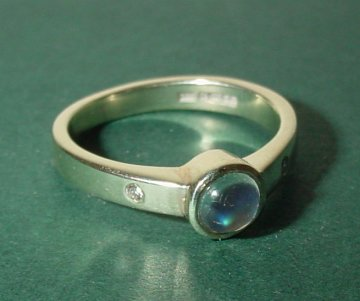 a 9ct white gold engagement ringwith a blue moonstone anddiamonds
