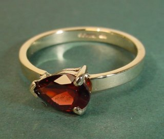 9ct yellow gold engagement ring with a peardrop shaped garnet