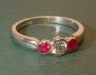 platinum engagement ring with an hsi brilliant cut diamond and two fine rubies