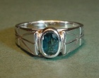 9ct white gold engagement ring with blue/greenceylon sapphire and engraved lines