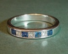 18ct white gold channel set ring with princess diamonds and blue sapphires