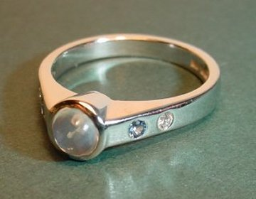 9ct white gold engagement ring set with a blue moonstone, ceylon sapphires and diamonds