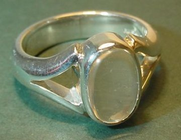 a sterling silver ring with a rare large blue moonstone