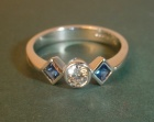 18ct white gold engagement ring with a diamond flanked by two ceylon sapphires