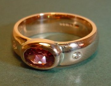 9ct rose gold engagement rings with a fine oval rhodalite garnet