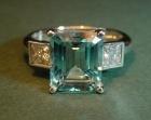 an aquamarine and diamond engagement ring set in platinum
