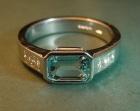 an aquamarine and diamond engagement ring in platinum