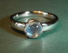a platinum and blue moonstone engagement ring
