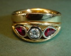 a yellow gold engagement and wedding ring set with rubies and diamonds