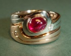 a platinum, rose gold and ruby ayres rock inspired ring set