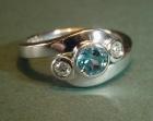a platinum, diamond and aquamarine engagement ring