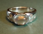 a platinum and moonstone engagement ring
