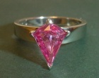 an art deco inspired platinum solitaire with a rare pink sapphire