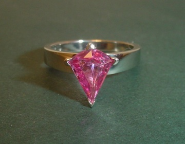 An Art Deco Inspired Platinum Solitaire With A Rare Pink