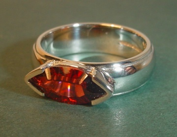 9ct white gold engagement ring with a laser cut 1.95ct garnet