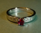platinum engagement ring with a fine rubyand hsi diamonds
