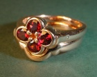 9ct rose gold engagement ring with garnets and diamonds