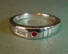 platinum ring with tapered baguette diamond and ruby