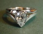 platinum engagement ring with 0.76ct pear shaped diamond