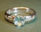 18ct white gold engagement ring with laser cut aquamarine and diamonds