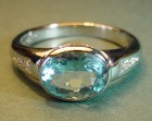 platinum ring with 1.42cts oval aquamarine and channel set diamonds