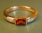 18ct rose gold diamond and russet garnet engagement ring