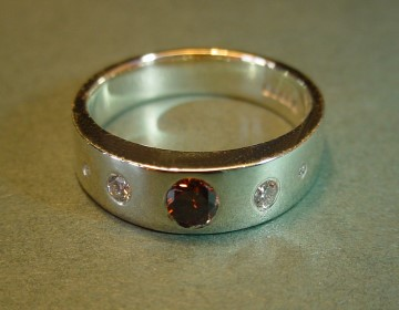 simple 9ct white gold ring with chocolate cognac and white diamonds