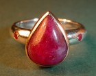 dramatic 18ct gold ring with unusual pear shaped cabochon ruby