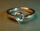 platinum 'rain drop' ring, set with a beautiful pear shaped aquamarine