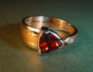one off optic cut trillion 1.29cts garnet a-symmetrical 9ct red and white gold engagement ring with 1mm brilliant cut h si diamond