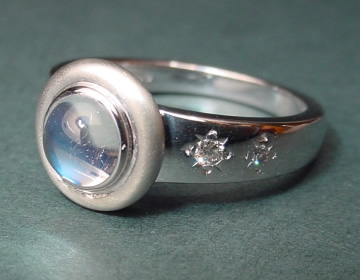 moonstone and diamond 9ct white gold engagement ring inspired by the night sky