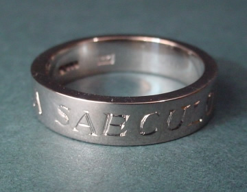 simple chunky 18ct white gold wedding band with latin engraving