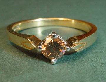 18ct engagement ring with 0.45cts cognac black diamond