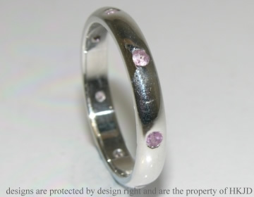 9ct white gold eternity ring with 7 pale pink sapphires
