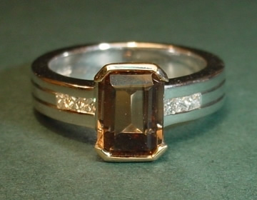 unique 9ct white and yellow gold engagement ring with 1.56ct emerald cut smoky quartz