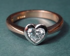 18ct rose gold and platinum ring with 0.41cts heart shaped h si diamond