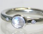 platinum engagement ring with a blue moonstone and 1.5mm diamonds