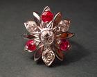bespoke flower inspired cluster ruby and diamond engagement ring