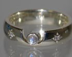 9ct white gold engagement ring with a central moonstone and side diamonds
