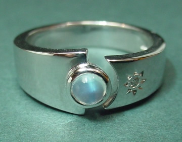 9ct white gold engagement ring with blue moonstone and diamond