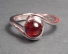 bespoke twist style garnet engagement ring