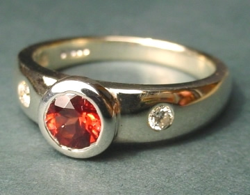 white gold garnet and diamond engagement ring with open tipped setting