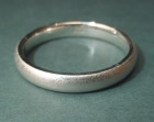 white gold wedding ring with a tunstall finish